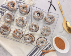 12 iced donuts on cooling rack